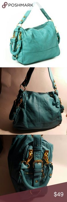 *Sale* Amrita Singh Mira handbag in Turquoise Soft, faux-leather with a delicate natural grain and polished hardware. Two removable side handles with lobster clasps and one shoulder strap, condition 9/10, no tears, no stains, probably few small scuffs on the bottom of the bag, and one very small on the handle. If you have any questions or you want to request more pictures of the bag, don't hesitate to ask me. Thanks for your time. Amrita Singh Bags Shoulder Bags