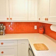Our Lush 3x6 glass subway tile in Poppy orange. www.modwalls.com