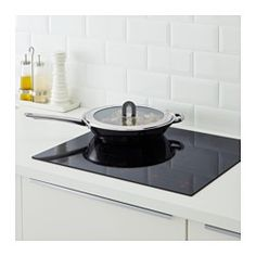 "IKEA - STABIL, Lid, Fits most frying pans 12"" in diameter.The handle can be folded down to save space when storing.Using the lid brings the contents of the pot to a boil faster, so that you can save time, energy and money while lowering your environmental impact."