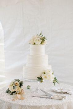 Elegant white floral topped wedding cake: http://www.stylemepretty.com/maryland-weddings/baltimore/2016/03/24/classic-elegant-maryland-horse-farm-wedding/   Photography: Shannon Michele - http://shannonmichelephotography.com/