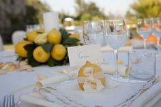 long wedding tables with flowers and candles and lemons - Google Search