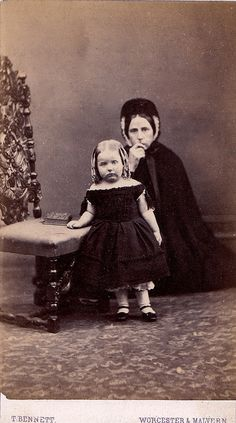 Amazing photo of child and mother. Looks as though they could be in mourning, second stage, but it is rare to see children all in black.