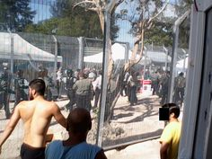 """Unconfirmed reports of fresh violence at the Manus Island detention centre have emerged, with refugee advocates claiming that security guards and locals have attacked protesters inside the Oscar and Delta Compounds. The Refugee Action Collectivehas claimed that security guards began """"attacking and beating protesters"""" around 4pm, Manus Island time. Collective spokesman Chris Breen provided SBS with photos, which he claimed showed guards, police, locals and the Transfield Emergency Response…"""