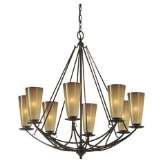 The unique suspension takes center stage in this indoor chandelier, with slim, graceful arms and plenty of light to go around! Finished in Mocha Bronze, with warm striated ivory glass. Supplied with 180 of wire and 60 of chain. Total maximum height: 95