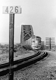 "qstation:  ATSF #304 (EMD F7) crosses the Sibley Bridge at Sibley, MO in July 1969 from ""Significant Images of Railroading""."