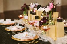 love the centerpiece with tiny candles and black   pink palette