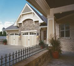@Clopay Doors | Residential Garage Doors and Entry Doors | Commercial Doors Coachman Steel Carriage House Style Garage Doors Series 1 Design 12 Almond Base with White Overlay, Arch 3 Glass & Decorative Hardware