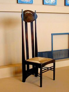 The tall chair, designed about 1897 for Catherine Cranston's Argyll Street tearooms in Glasgow. According to museum notes, it's an important work in the British Arts and Crafts Movement. The high back helped provide privacy for tearoom patrons. This is located in an exhibit of Charles Rennie Mackintosh's (1868-1928) work at the Virginia Museum of Fine Arts in Richmond, Virginia.