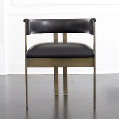 "KELLY WEARSTLER | ELLIOTT CHAIR. Crafted in leather and 1/2"" solid bronze stock."