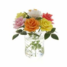 Martha Mclean Miniatures - international artisan dollhouse miniatures and handcrafted dollhouse flower arrangements - Roses in blown glass vase $85
