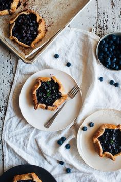 Recipe for perfect individual sized lemon-thyme blueberry galettes.