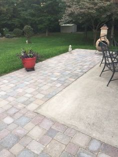 Extending concrete patio with pavers