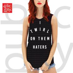 """DETAILS Unisex I TWIRL ON THEM HATERS Muscle Tank. 100% Cotton. Round-Neckline. Relaxed Fit. High-Quality Screen Printed Graphic. MEASUREMENTS S [Bust: 34-36""""; Body Length: 25""""] M [Bust: 36-38""""; Body"""