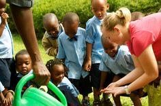 Laura DeRosier '13 introduces students to a fuzzy friend at SOS Primary School during a summer field study in Kigali, Rwanda. #cordmn #education #teacher #rwanda #kigali
