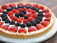 Mixed Fruit Tart Recipe - Valerie I'm mostly interested in the cream cheese whipped cream filling. Also has a shortbread crust and apricot preserves glaze.