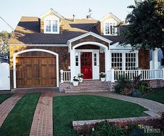White paint lets this home's columns, porch railings, window and door trim take center stage.