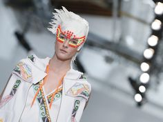 Click to see seriously cool photos of bizarre styles at Paris Fashion Week
