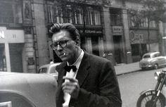 A smoking Robin Day on Kingsway, 1957.