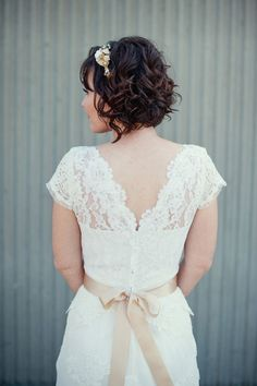 Wedding Dress: Friend's mother made it from bride's mother's dress