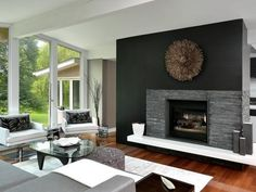 Contrast is king in this fireplace wall by Nathalie Tremblay of Atelier Cache, post-renovation and re-design. Gone are the drab wall and white brick; in their place, a stone-veneer surround and black wall add plenty of drama, and a three-dimensional art piece adds the finishing touch.