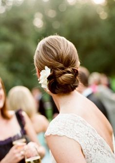 I'd like to have my hair like this in the back with a simple flower that matches my bouquet (but not a white flower please)