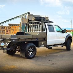 Ford F350 Aluminum Flatbed in Leopard style (hpi black w/ shaved diamonds) with matching underbody boxes, mud flaps, and an over cab tire rack. Sweet Ride!  Learn more about HPI Aluminum Flatbeds >>> http://www.highwayproducts.com/products/aluminum-flatbeds  (at highway products inc)