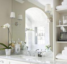 Elegant wall lights inserted into bathroom mirror