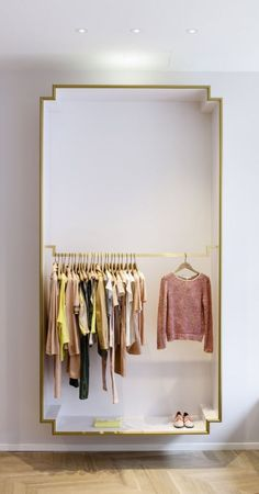 Gilded molding frames a box wardrobe — an elegant solution for open area clothing storage/display | Architectural concept by Elements for Maje boutique:
