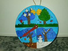 Fénymásolt lapon megkapták a gyerekek a kiszínezendő alapot, majd körbenyírták, a mutatót és magát az órát miltonkapoccsal rögzítettük a medvesajtos dobozhoz. Raffia akasztóval láttuk el.    <<< Nagyobb méretű sablonhoz katt a képre!    >>> Bukor Ildikó alkotásai
