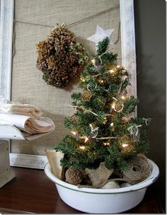 Love this idea of using an enamel bowl to display a small Christmas tree