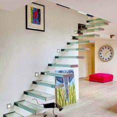 escaleras de cristal que amplan la sensacin de espacio