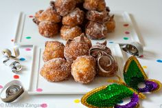 """Tortelli di Carnevale - fluffy """"puffs"""" fried and coated in sugar, a typical Italian sweet eaten during Carnevale."""