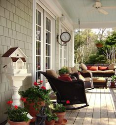 Would love to have a porch swing like the one on the end (along with plants that won't die).