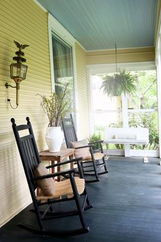 With the requisite rocking chairs and porch swing, the screened-in front porch is a perfect spot to relax.