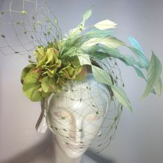 A personal favorite from my Etsy shop https://www.etsy.com/listing/264234532/lime-green-fascinator-detby-hat-ascot