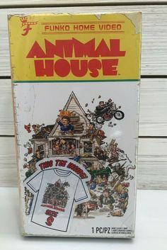 Animal House XL shirt in VHS style box Funko Home Video Funko Batman Figures, Vinyl Figures, Xl Shirt, Tee Shirts, National Lampoon's Animal House, National Lampoons, Boxing T Shirts, Movie T Shirts, Funko Pop Vinyl
