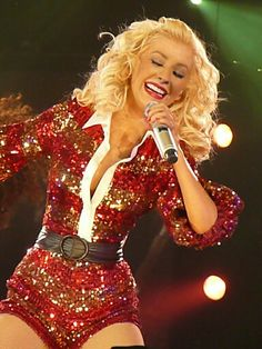 """Christina Aguilera singing """"What A Girl Wants"""" during the """"Back to Basics World Tour"""". Xtina wore a red sequin """"Santa"""" outfit. Christina Aguilera Burlesque, Celebrity Summer Style, Celebrity Moms, Celebrity Outfits, Beautiful Christina, Christina Ricci, Santa Outfit, What A Girl Wants, Stage Outfits"""