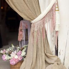 Inexpensive burlap fabric tied with scarfs, so bohemian