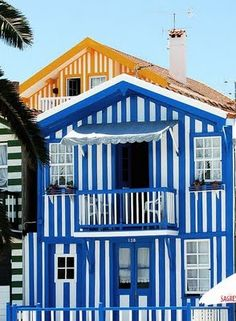 Striped houses in Costa Nova, Aveiro, Portugal. Could these houses be any more beachy and fun? Costa Nova Portugal, Spain And Portugal, Visit Portugal, Portugal Travel, Beautiful World, Beautiful Places, Beautiful Buildings, Monuments, Shades Of Blue