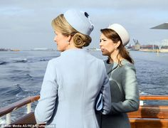 Both women looked chic in pastel coats and pillbox hats as they enjoyed an afternoon on the river