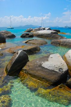 Virgin Gorda, British Virgin Islands    See that dry rock in the background? That's gonna be my rock. I will sit there and ponder the world and watch the waves roll by. How will I get to this rock in this tropical paradise? The sailboat behind the rock, obviously.