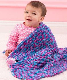 Speedy One-Row Baby Blanket | Work up this adorable knit baby blanket in no time. So speedy!