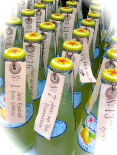 limonata name card- put table names with numbers on little champagne bottles