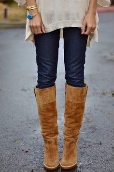Over the knee boots with skinny jeans and a long shirt. So cute.