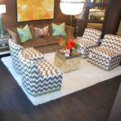 C.R. Laine earned our coveted HOT button with this amazing room.  Love the pattern on the chairs, the marbled mirror table and the nailhead detail on the couch!  TheHome.com #hpmkt