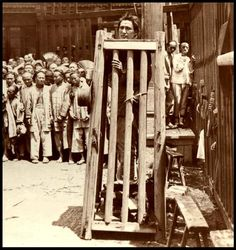 Sometimes, a quick beheading was the easy way out. Here, a man is pictured standing in a box, as a crowd watches his progress. This is not a posed shot. The convicted man has been here for a few days. He is standing on a pile of thin stones (or wooden planks). Every day, one piece is pulled out, until you can no longer stand, and either your neck snaps under the weight of your body pulling on it, or else you slowly strangle to death.