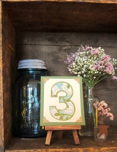 Custom Wedding Table Number -                          Tiny Art w/ Easel - Rustic, Vintage-Inspired, Natural. $9.25, via Etsy.