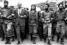 Castro and Guevara Marching