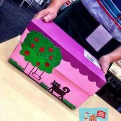 A beautiful box, hand painted and decorated as a dollhouse. Hours of fun play! Such a creative idea!