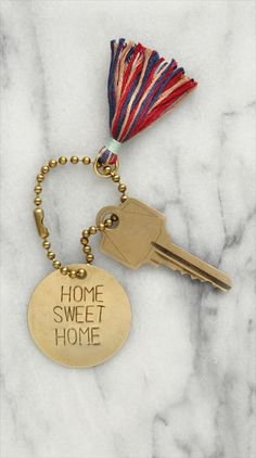 "Not technically for ""room decorating"" -- but it is a crafty idea and it is for your room, so it works! Turn a brass tag into a stylish keychain using metal stamps, a hammer and this simple tutorial."